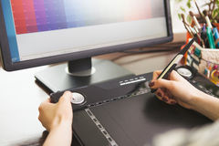 Woman working with graphic tablet Royalty Free Stock Photo