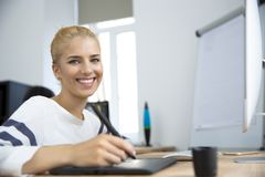 Woman working on graphic tablet Stock Image