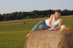 Woman working on a haystack Royalty Free Stock Images