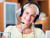 Woman working  with headset Royalty Free Stock Photography