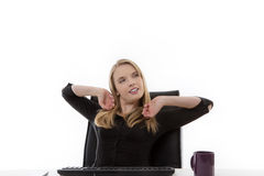 Woman working at her desk Stock Image