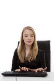 Woman working at her desk Royalty Free Stock Photography