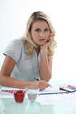 Woman working at her desk Stock Photography