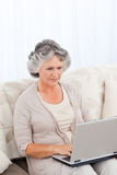 Woman working on her laptop Royalty Free Stock Photo