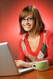 Woman working on her laptop Stock Photos