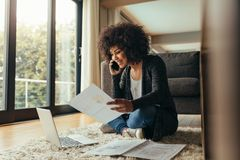 Woman working from her living room Stock Image