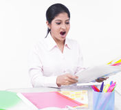 Woman working at her office desk. Young woman working at her office desk Royalty Free Stock Photos