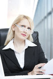 Woman working in her office. Lady working in her office Royalty Free Stock Photo
