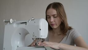 Woman working on the sewing machine stock footage