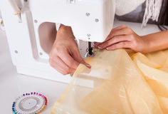 Woman working with her sewing machine Stock Image