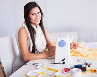 Woman working with her sewing machine Royalty Free Stock Photos