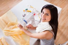 Woman working with her sewing machine Stock Photo