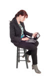 Woman working with her tablet. Royalty Free Stock Image
