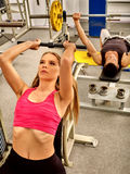 Woman working his arms and chest at gym Royalty Free Stock Photo