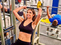 Woman working his arms and chest at gym. Stock Photography