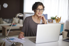 Woman working at home Stock Image