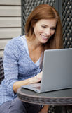 Woman working home on laptop Stock Photography