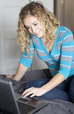 Woman working home on a laptop Royalty Free Stock Photos