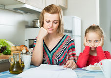 Woman working from home, little daughter asking for attention Royalty Free Stock Photos
