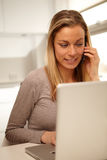 Woman working from home office Royalty Free Stock Photos
