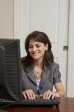 Woman Working at Home Office Stock Images