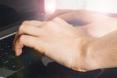 Woman working at home office hand on keyboard close up.  Stock Image