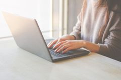 Woman working at home or office hands on keyboard  laptop. stock photography