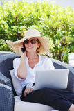 Woman working at home Stock Images