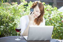 Woman working from home sitting outdoors Stock Images