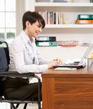 Woman Working From Home Using Laptop Royalty Free Stock Photography