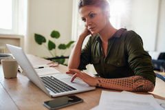Woman working from home using laptop Royalty Free Stock Photo