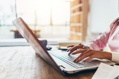 Woman working from home using notebook computer royalty free stock photo