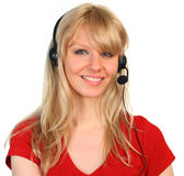 Woman working on a hotline. At a customer service department Royalty Free Stock Photos