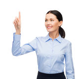 Woman working with imaginary virtual screen Stock Photos