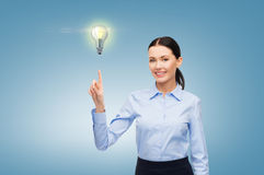 Woman working with imaginary virtual screen Royalty Free Stock Image