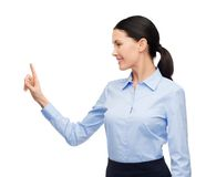 Woman working with imaginary virtual screen Royalty Free Stock Images