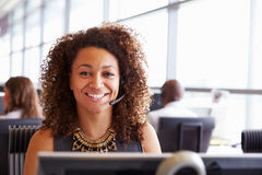 Free Woman Working In A Call Centre, Looking To Camera, Close-up Stock Image - 59933501