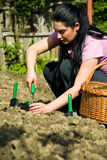 Woman Working In Garden And Using Tools Royalty Free Stock Images