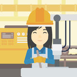 Woman working on industrial drilling machine. Royalty Free Stock Image
