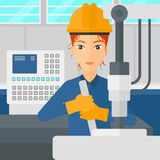 Woman working with industrial equipment. Royalty Free Stock Photography