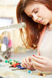 Woman working in jewelry workshop Royalty Free Stock Photos