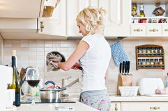 Woman working in the kitchen Royalty Free Stock Photos