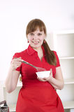 Woman working in the kitchen Stock Photography