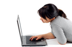 Woman working on laptop #12. Attractive woman with laptop on white background Stock Image