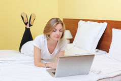 Woman working on laptop Stock Image