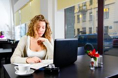 Woman is working on laptop Stock Image