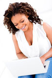 Woman working on a laptop Royalty Free Stock Image