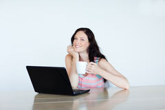 Woman working with a laptop Royalty Free Stock Photography