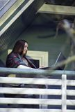 Young woman, laptop, terrace, cup of tea, nature royalty free stock photos