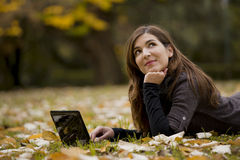 Woman working with a laptop. Beautiful woman working with a laptop in outdoor Royalty Free Stock Photo